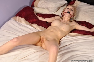 With a shaved pussy, naked submissive blonde squirming as she is tied spread eagle on the bed - XXXonXXX - Pic 12