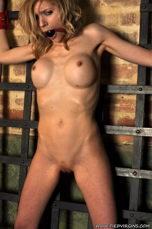 Horny and very naked blonde virgin shows vexation with being bound on her wrists and ankles on lattice bars - XXXonXXX - Pic 12
