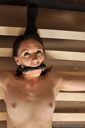 Brunette beauty looks patiently anticipating hardcore action while she is securely tied spread eagle on a bed rack - XXXonXXX - Pic 9