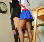 Two horny coeds take off each other's very tight uniform leaving them