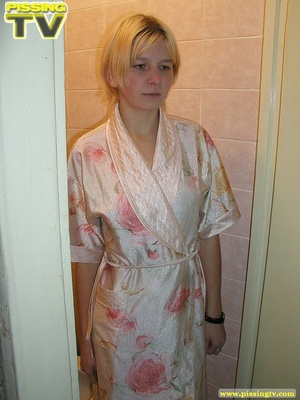 A slutty blonde bitch demonstrates how enjoyable  taking a piss in the toilet can be - XXXonXXX - Pic 1