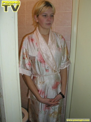 A slutty blonde bitch demonstrates how enjoyable  taking a piss in the toilet can be - XXXonXXX - Pic 2