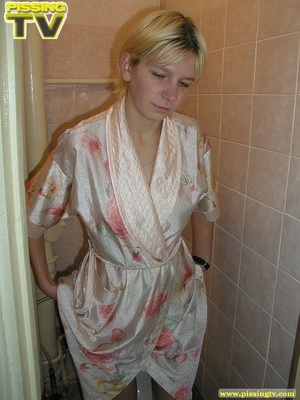 A slutty blonde bitch demonstrates how enjoyable  taking a piss in the toilet can be - XXXonXXX - Pic 4