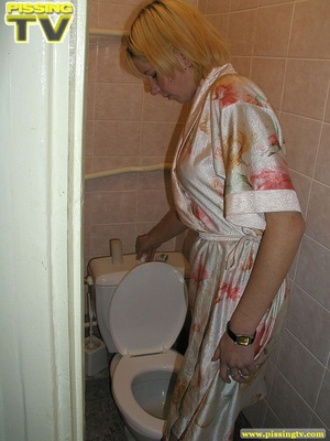 A slutty blonde bitch demonstrates how enjoyable  taking a piss in the toilet can be - XXXonXXX - Pic 20