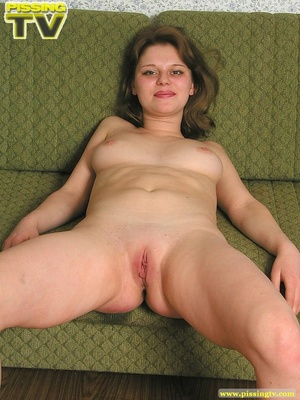 Nasty busty brunette beauty lounges on a living room sofa naked then positions herself and releases a golden shower of pee on the floor - XXXonXXX - Pic 19