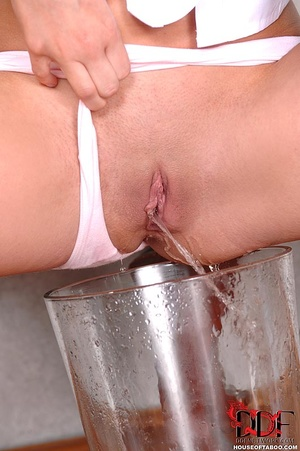 Nasty naughty brunette slut is excited at being caught pissing in a vase righ there in the living room - XXXonXXX - Pic 11