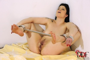 Lovely brunette temptress is restrained in spreader bars on her ankles and wrists lying down on a bed, since she isn't going anywhere she just pissed on bed - XXXonXXX - Pic 6