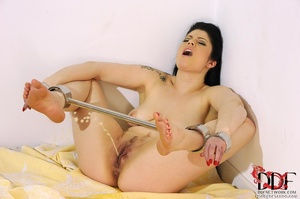Lovely brunette temptress is restrained in spreader bars on her ankles and wrists lying down on a bed, since she isn't going anywhere she just pissed on bed - XXXonXXX - Pic 8