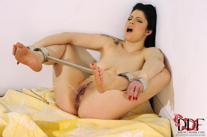 Lovely brunette temptress is restrained in spreader bars on her ankles and wrists lying down on a bed, since she isn't going anywhere she just pissed on bed - XXXonXXX - Pic 9