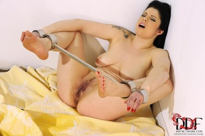 Lovely brunette temptress is restrained in spreader bars on her ankles and wrists lying down on a bed, since she isn't going anywhere she just pissed on bed - XXXonXXX - Pic 10