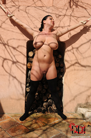 Very busty brunette beauty is tied spread eagled outdoors along the wall of a house and had no qualms about pissing right there - XXXonXXX - Pic 12
