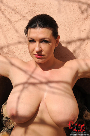 Very busty brunette beauty is tied spread eagled outdoors along the wall of a house and had no qualms about pissing right there - XXXonXXX - Pic 16