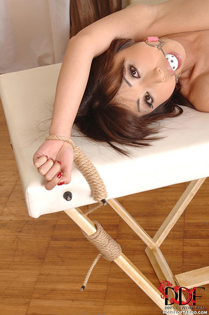 Lovely naked massuese gagged and is tied to her massage table on her side since she could not leave she just pissed on table - XXXonXXX - Pic 13