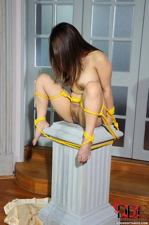 A busty asian girl is tied and propped onto a pedestal with legs wide open then she is allowed to piss right there - XXXonXXX - Pic 16