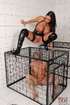 busty brunette dom cages