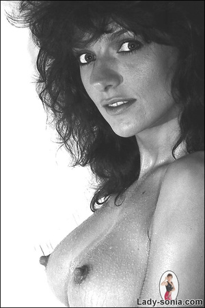 Curly haired brunette lounging on the be - XXX Dessert - Picture 6