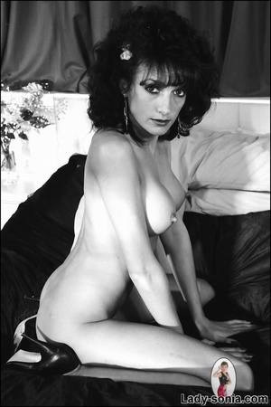 Curly haired brunette lounging on the be - XXX Dessert - Picture 7