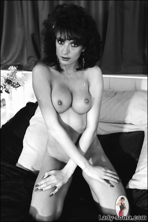 Curly haired brunette lounging on the be - XXX Dessert - Picture 8