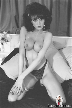 Curly haired brunette lounging on the be - XXX Dessert - Picture 10