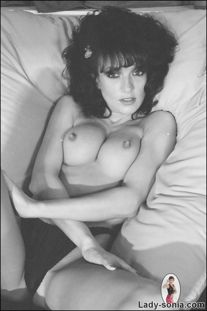 Curly haired brunette lounging on the be - XXX Dessert - Picture 12
