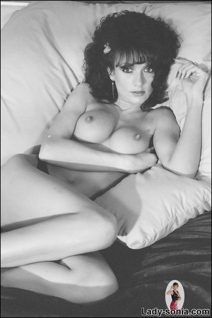 Curly haired brunette lounging on the be - XXX Dessert - Picture 13
