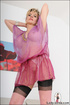 Hot blonde mama tempts to the extreme with her sheer pink blouse and see
