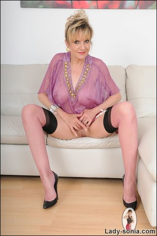 hot blonde mama tempts