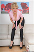 Blonde hot mama in pink blouse, hot spandex pants, and heels teasingly