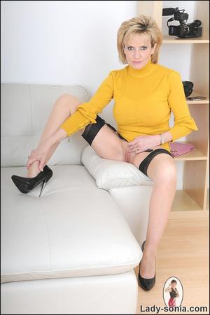 Alluring blonde MILF playfully teases wi - XXX Dessert - Picture 9