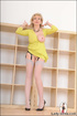 Horny mature exhibitionist wears no panties under a yellow dress and flashes