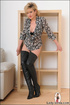 Alluring classy MILF in long black boots tempts relentlessly while revealing