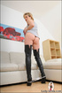 Hip and youthful MILF seduces in long black boots and tanktop simply gives