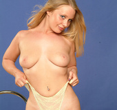 Big-titted blonde babe is ready to take off her panties for you