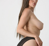 Long-haired chick with mega tits topless in black panties