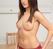 Long-haired brunette in red panties rubbing her nipples