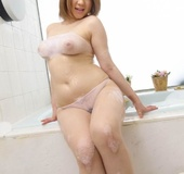 Busty short haired beauty plays in the shower with her lovely hairy cunt