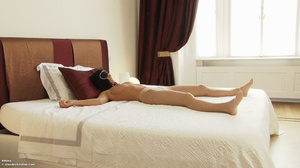 Athina is laying on the bed in pantyhose - XXX Dessert - Picture 1
