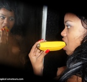 Breath-taking swarthy freshie licking wooden banana in front of the mirror