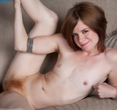 Hot lady with red hair on her head, pussy and in pits strips off to show