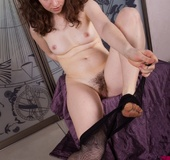 Lusty looking white chick with cute small tits strips off and shows hairy