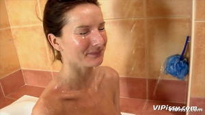 Babe in bath washes herself with hot piss before being sprayed by guy with piss - XXXonXXX - Pic 11