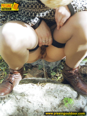 Cute short hair blonde bends down to take a piss out in the woods in early autumn - XXXonXXX - Pic 12