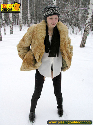 Cute white teen in fur coat, shirt and pantyhose takes an piss in the snow - XXXonXXX - Pic 2