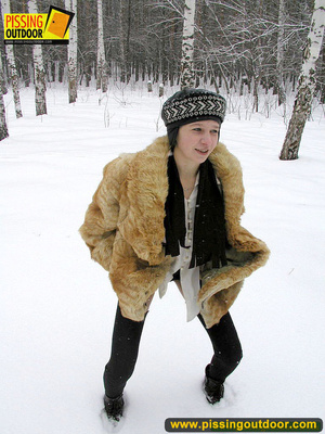 Cute white teen in fur coat, shirt and pantyhose takes an piss in the snow - XXXonXXX - Pic 3