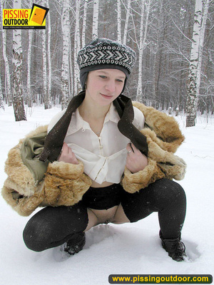 Cute white teen in fur coat, shirt and pantyhose takes an piss in the snow - XXXonXXX - Pic 7