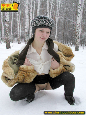 Cute white teen in fur coat, shirt and pantyhose takes an piss in the snow - XXXonXXX - Pic 8