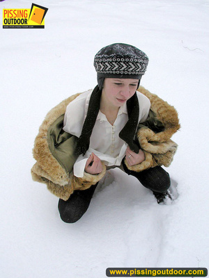 Cute white teen in fur coat, shirt and pantyhose takes an piss in the snow - XXXonXXX - Pic 14