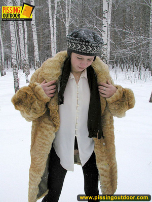 Cute white teen in fur coat, shirt and pantyhose takes an piss in the snow - XXXonXXX - Pic 17