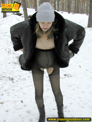 Pregnant young teen in jacket and pantyhose releases a stream of piss in the snow - XXXonXXX - Pic 2