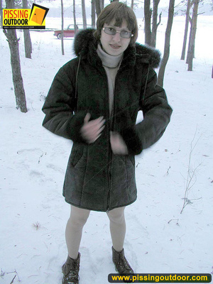 Kinky teen in glass bends to piss in the snow revealing tits and cute bushy pussy - XXXonXXX - Pic 1
